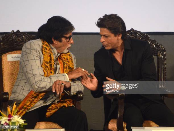 Indian Actor Amitabh Bachchan and Shah Rukh Khan sharing moments during the inauguration ceremony of 23rd Kolkata International Film Festival in...