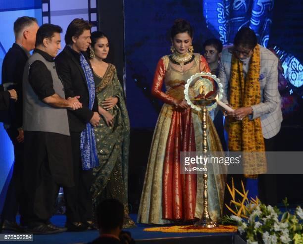 Indian Actor Amitabh Bachchan lights the lamp with Kamal Hasan Shah Rukh Khan Kajol during the inauguration ceremony of 23rd Kolkata International...