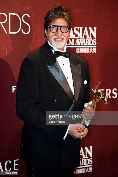 Indian actor Amitabh Bachchan poses backstage after winning the after winning the Lifetime Achievement Award during the 4th Asian Film Awards...