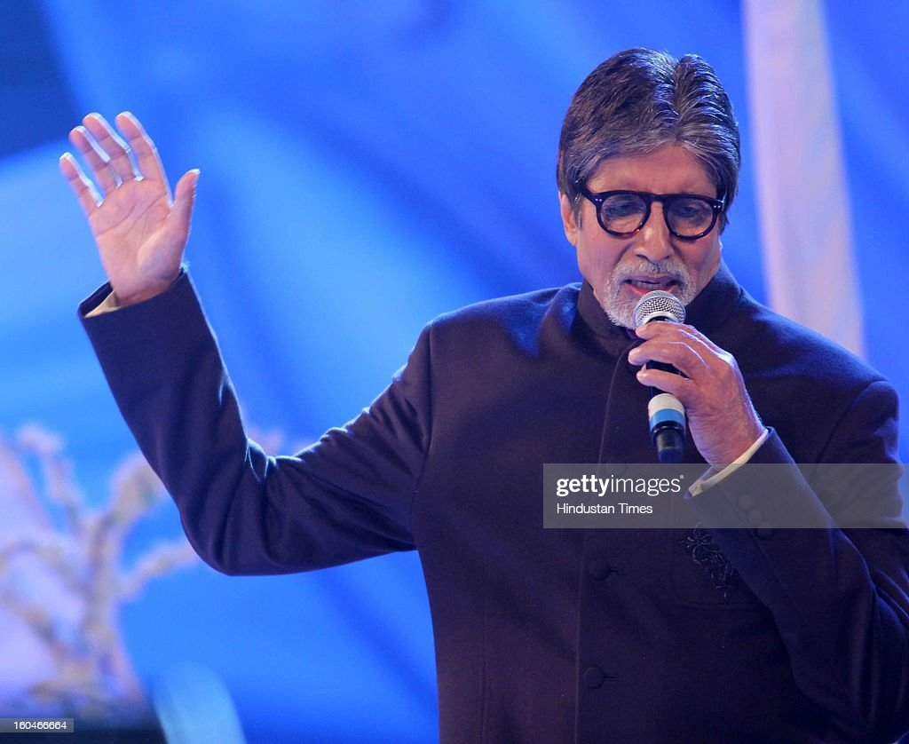 Indian Actor Amitabh Bachchan singing during Global Sound of Peace Concert and Album Launch at Andhery Sports Complex on January 30, 2013 Mumbai, India.