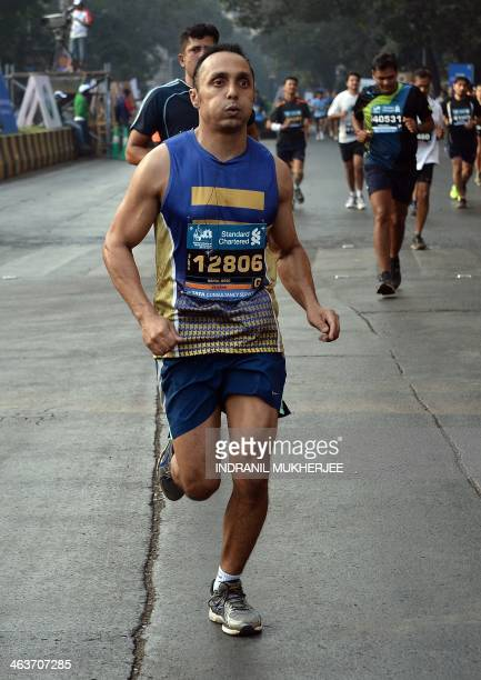 Indian actor and activist Rahul Bose runs as he takes part in the Mumbai Marathon on January 19 2014 Thousands of people turned out on a cool morning...