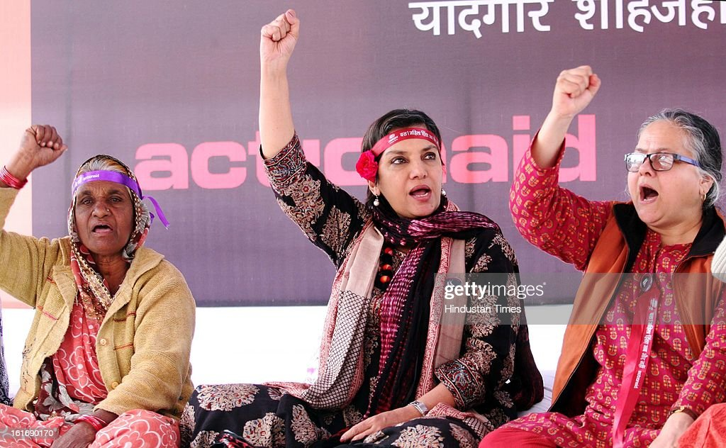 Indian Actor and activist Shabana Azmi (C) raising slogan at a Program organized by Jan Pahal at Yadgar-e-Shahjahani park to mark the conclusion of One Billion Rising campaign against violence on women on February 14, 2013 in Bhopal, India.