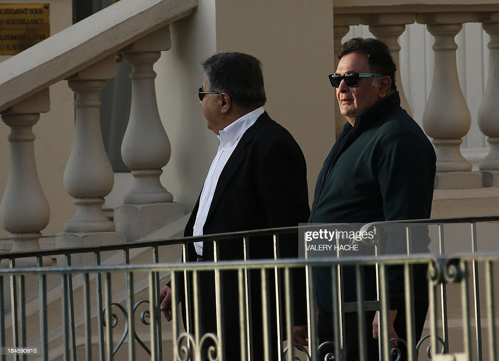 Indian actor and director Rishi Kapoor (R) stands outside the Carlton Hotel in the southeastern French city of Cannes on October 14, 2013 during the wedding party of a London-based Indian couple. The Carlton palace was entirely booked for several nights to accomodate guests for the wedding of Grover and Ria Dubash.