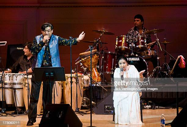 Indian actor and singer Amit Kumar performs with Asha Bhosle performs at the latter's '75 years of Asha' concert at Carnegie Hall New York New York...