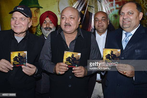 Indian actor Arun Bakshi and producer Deepak Maini pose during an album launch Amritsar on February 14 2014 Bakshi is in the city to launch of his...