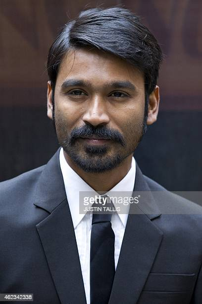 Indian actor Dhanush poses for photographers at a photocall for the film 'Shamitabh' in central London on January 27 2015 AFP PHOTO / JUSTIN TALLIS