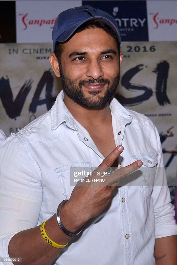 Indian actor Harish Verma gestures during a promotional event for the forthcoming Punjabi film 'Vaapsi' in Amritsar on May 30, 2016. / AFP / NARINDER