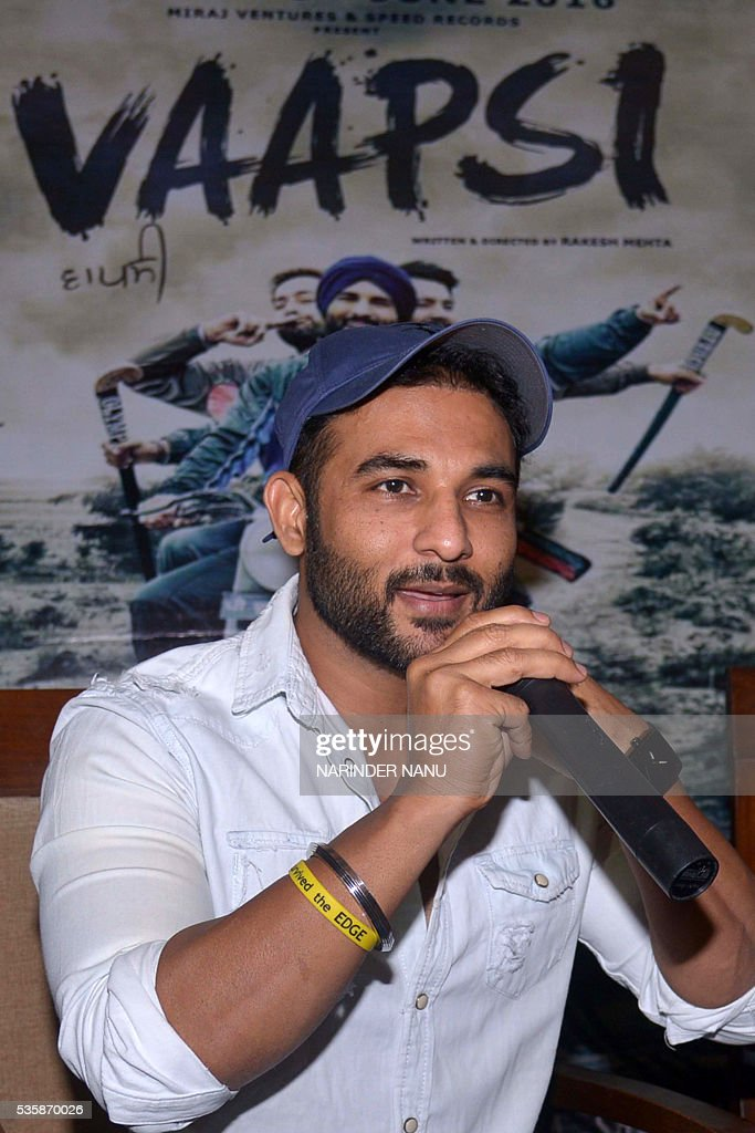 Indian actor Harish Verma speaks during a promotional event for the forthcoming Punjabi film 'Vaapsi' in Amritsar on May 30, 2016. / AFP / NARINDER