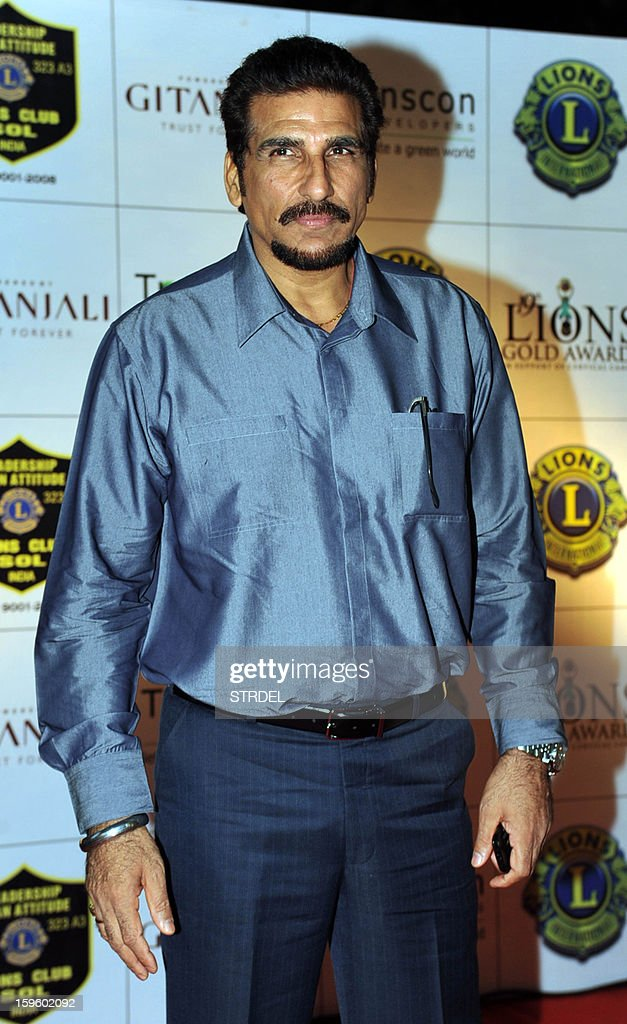 Indian actor Mukesh Rishi poses during the Lions Gold Awards ceremony in Mumbai on January 16, 2013.