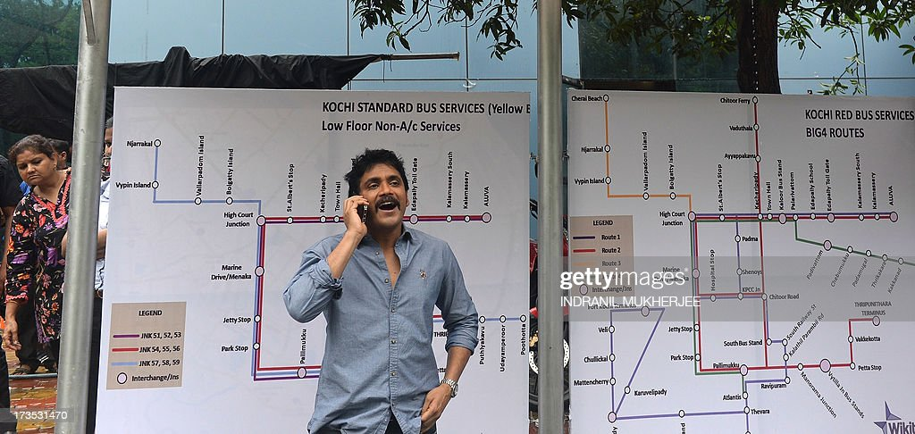 Indian actor Nagarjun speaks on his mobile phone as he waits to shoot a television commercial for a leading jewellery house in Mumbai on July 16, 2013. Indian filmstars who enjoy demigod status among their fans are the most sought after by entrepreneurs for endorsing brands from shampoo to shoe lace.