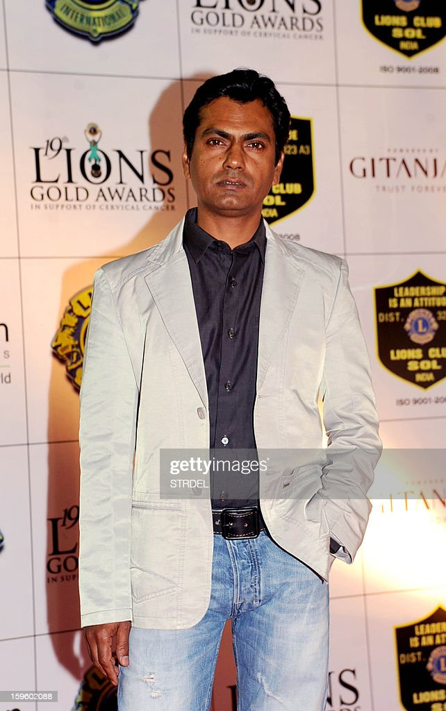 Indian actor Nawazuddin Siddiqui poses during the Lions Gold Awards ceremony in Mumbai on January 16, 2013.
