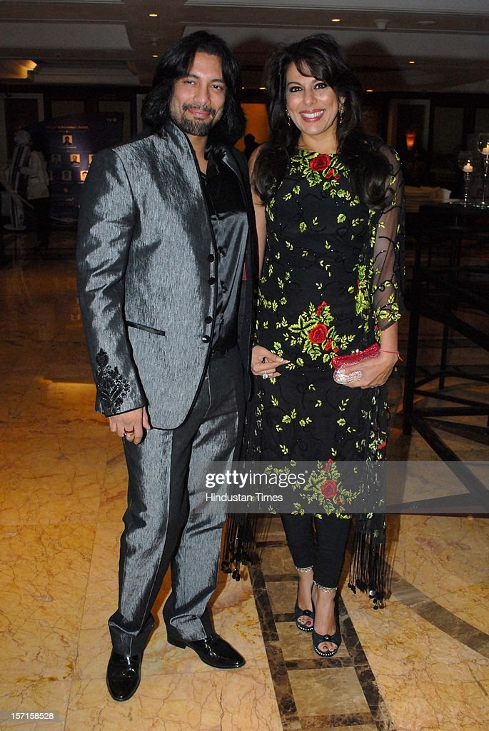 Indian actor Pooja Bedi with Akashdeep Sehgal during IBN 7 Super Idol awards 2012 ceremony at Taj Lands end, Bandra on November 25, 2012 in Mumbai, India.