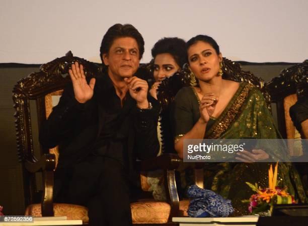 Indian Actor Shah Rukh Khan and Kajol sharing moments during the inauguration ceremony of 23rd Kolkata International Film Festival in Kolkata India...