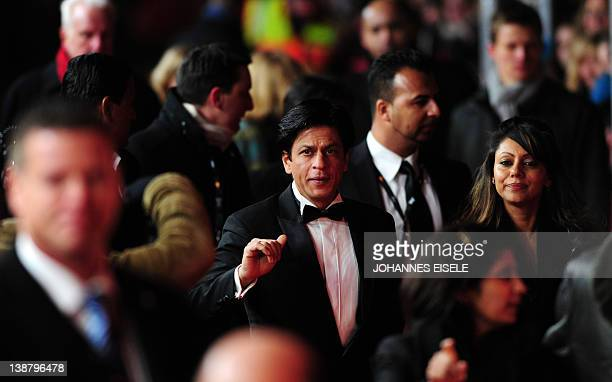 Indian actor Shah Rukh Khan arrives for the premiere of the film 'Don The King Is Back' in Berlin with his wife Gauri Khan on February 11 2012 The...