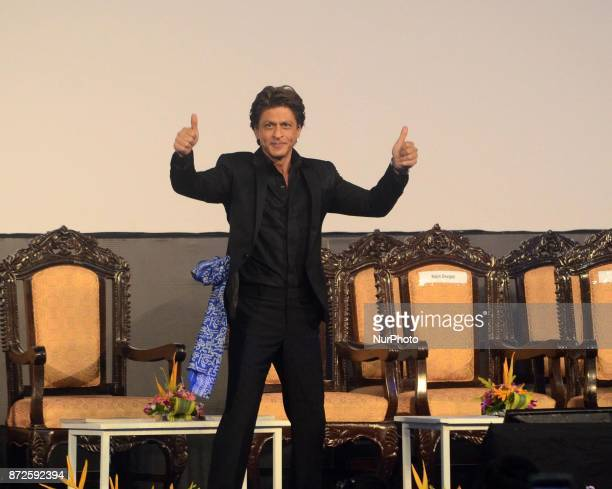 Indian Actor Shah Rukh Khan waves to the spectators during the inauguration ceremony of 23rd Kolkata International Film Festival in Kolkata India on...