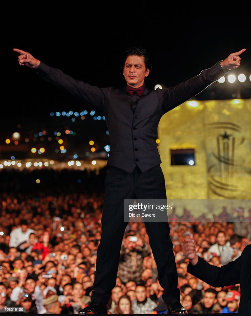 Indian actor Shahrukh Khan poses at Jemaa El Fna place during the Tribute To Hindi Cinema at 12th International Marrakech Film Festival on December 1, 2012 in Marrakech, Morocco.