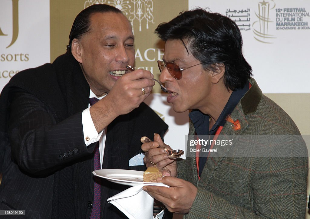 Indian actor Shahrukh Khan tastes moroccan food at Tal Palace Marrakech Hotel during the Tribute To Hindi Cinema at 12th International Marrakech Film Festival on December 1, 2012 in Marrakech, Morocco.