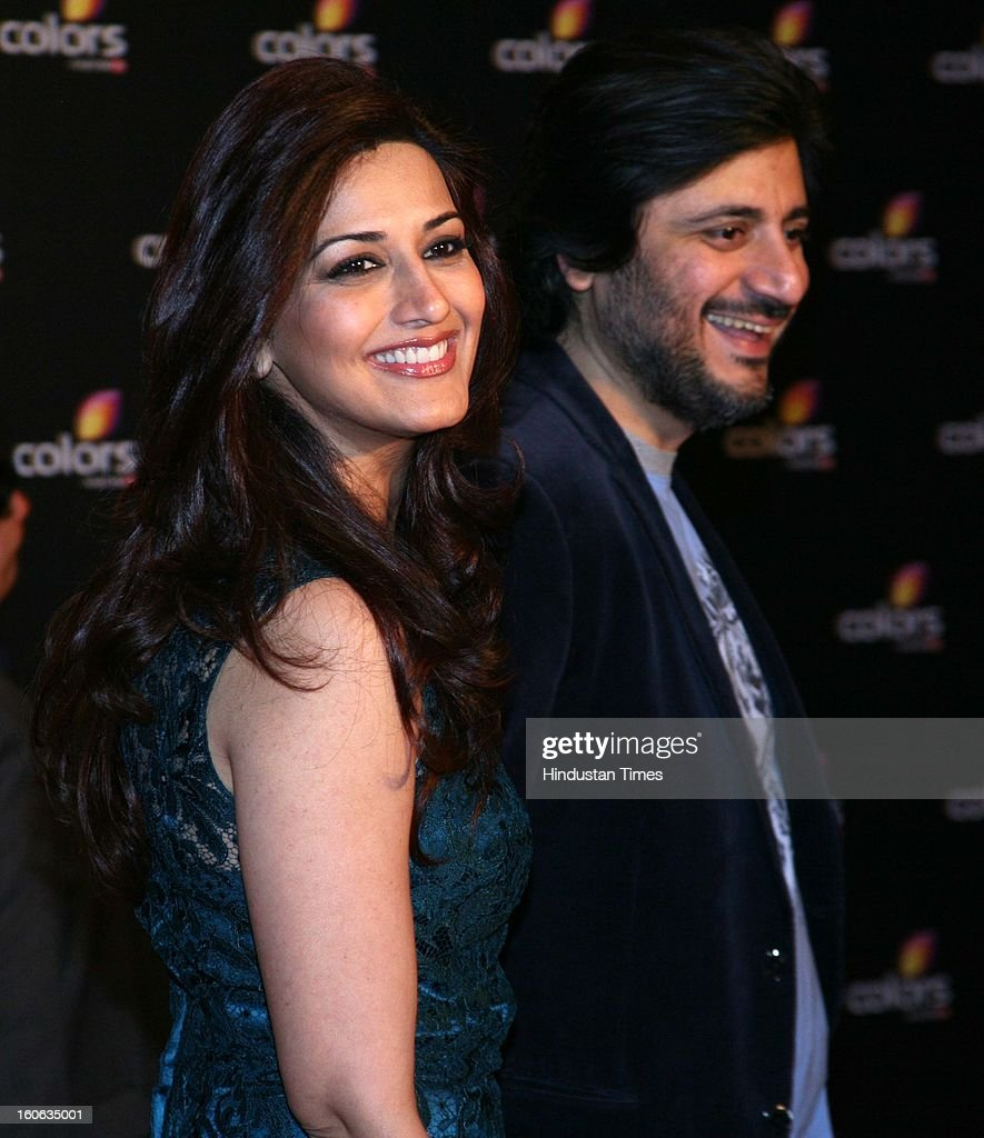 Indian actor Sonali Bendre with her husband Goldie Behl during 4th anniversary party of Colors at Grand Hyaat on February 2, 2013 in Mumbai, India.