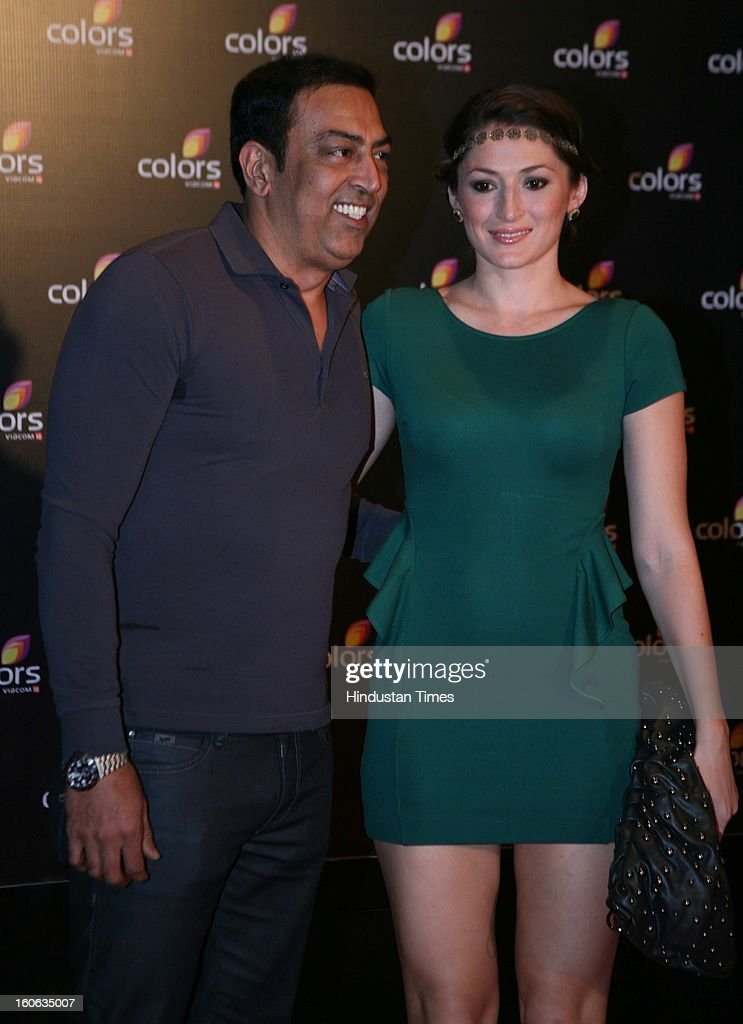 Indian actor Vindu Dara Singh with his wife Dina during 4th anniversary party of Colors at Grand Hyaat on February 2, 2013 in Mumbai, India.
