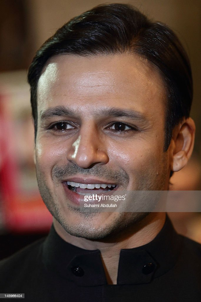 Indian actor <a gi-track='captionPersonalityLinkClicked' href=/galleries/search?phrase=Vivek+Oberoi&family=editorial&specificpeople=627274 ng-click='$event.stopPropagation()'>Vivek Oberoi</a> pose on the green carpet during the IIFA Rocks Green Carpet on day two of the 2012 International India Film Academy Award weekend at the Esplanade on June 8, 2012 in Singapore.