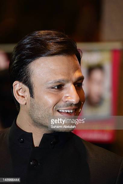 Indian actor Vivek Oberoi pose on the green carpet during the IIFA Rocks Green Carpet on day two of the 2012 International India Film Academy Award...