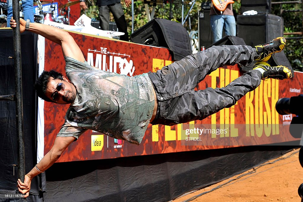 Indian actor VJ Rannvijay Singh Singha shows off an exercise move during the Mud Rush event in Kolad, India's Maharashtra state, on February 9, 2013.
