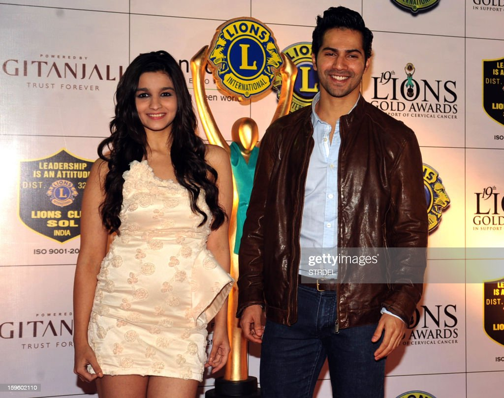 Indian actors Alia Bhatt and Varun Dhawan pose during the Lions Gold Awards ceremony in Mumbai on January 16, 2013.