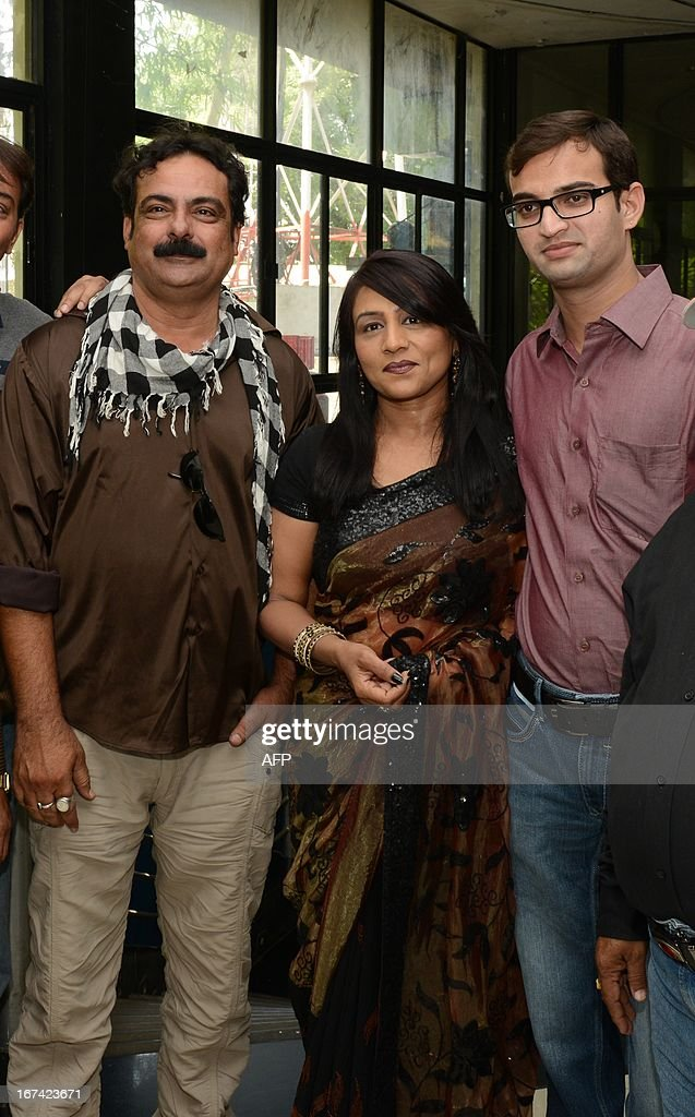Indian actors Alpna Majumdar (C), Bhaumik Nayak (R),and Rahim Khan, pose for a photo after watching their premiere on a film on homosexuality 'Meghdhanushya - Colour Of Life' during its premiere in Gandhinagar, some 30 kms. from Ahmedabad on April 25, 2013. Both Manvendra and Silvester acted in 'Meghdhanushya - The Colour Of Life' the first film in Gujarati language about the gay community and the problems faced by them in society. AFP PHOTO / Sam PANTHAKY