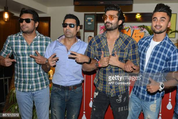 Indian actors Binnu Dhillon Dev Kharoud Yuvraj Hans and Ravneet Singh pose during a promotional event for the upcoming Punjabi film 'Bailaras' at an...