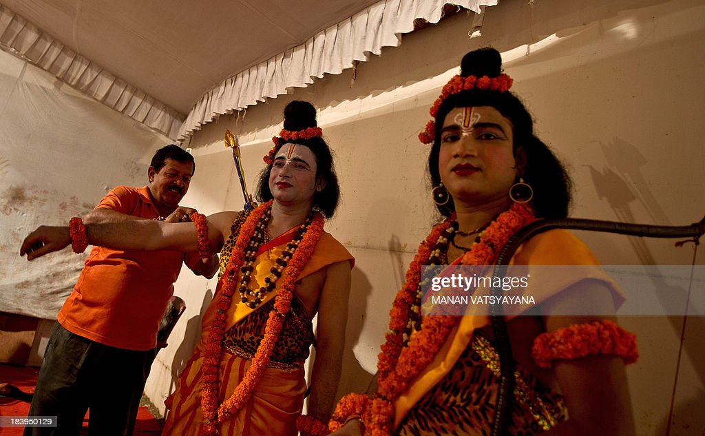 Indian actors dressed as Hindu Lord Ram and Laxman prepare backstage for a Ramlila performance a dramatisation of Hindu God Rama's life in New Delhi...