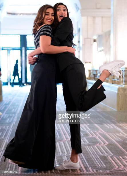 Indian actors Ileana D'Cruz and Athiya Shetty pose during a photocall to promote their upcoming Bollywood comedy Mubarakan which is currently...