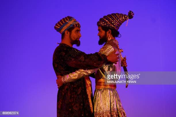 Indian actors perform a musical drama in Bangalore on March 27 during World Theatre Day / AFP PHOTO / MANJUNATH KIRAN