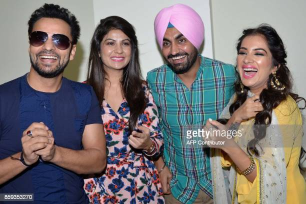 Indian actors Rajiv Thakur Geet Gambhir Ravinder Grewal and Sara Gurpal pose for a picture during a promotional event for the upcoming Punjabi film...