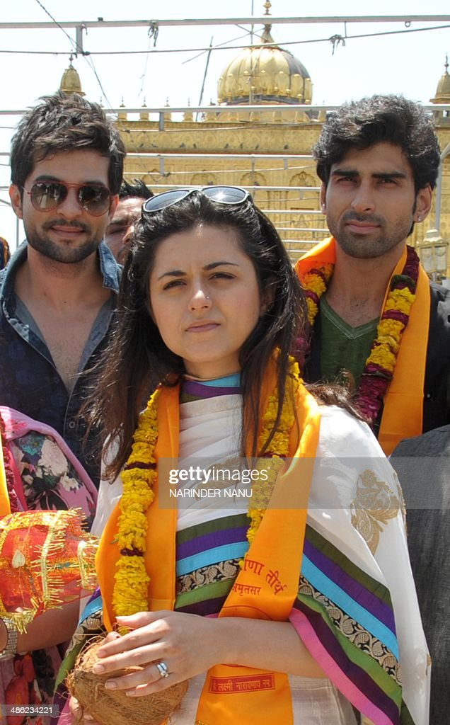 Indian actors Raqesh Vashisth (L) and Akshay Dogra (R), and television actress Ridhi Dogra Vashisth (C) pose for a photograph during a campaign event for Bharatiya Janata Party (BJP) senior leader and candidate for Amritsar's parliamentary seat Arun Jaitley at a temple in Amritsar on April 23, 2014. India's 814-million-strong electorate is voting in the world's biggest election which is set to sweep the Hindu nationalist opposition to power at a time of low growth, anger about corruption and warnings about religious unrest. AFP PHOTO/NARINDER NANU