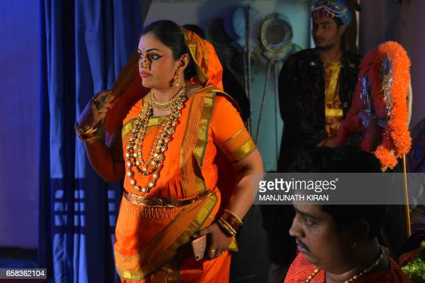 Indian actors watch a musical drama performance backstage during a performance of a musical drama in Bangalore on March 27 during World Theatre Day /...
