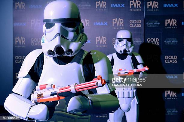 Indian actors wearing stormtrooper outfits from the 'Star Wars' movies take part in an inaugural event of PVR's IMAX theatre in Bangalore on December...