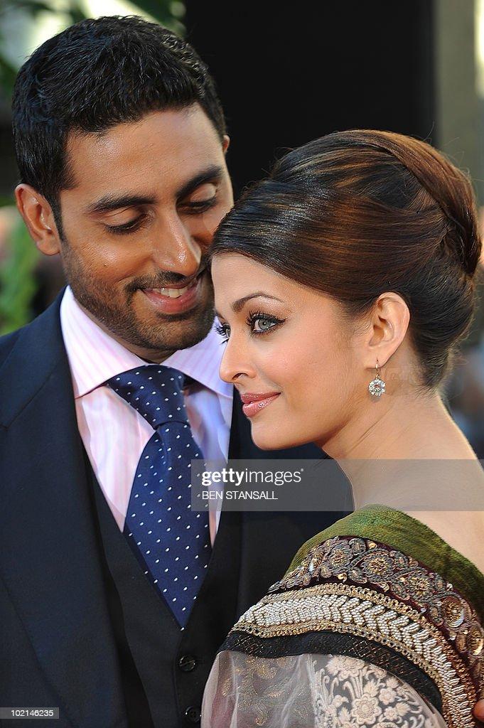 Indian actress Aishwarya Rai Bachchan (R) and husband Abhishek Bachchan attend the world premier of the film 'Raavan' in London on June 16, 2010.