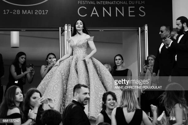 Indian actress Aishwarya Rai poses as she arrives on May 19 2017 for the screening of the film 'Okja' at the 70th edition of the Cannes Film Festival...
