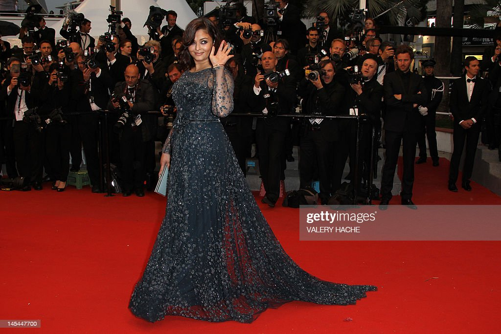 Indian actress Aishwarya Rai waves as she arrives for the screening of 'Cosmopolis' presented in competition at the 65th Cannes film festival on May 25, 2012 in Cannes. AFP PHOTO / VALERY HACHE