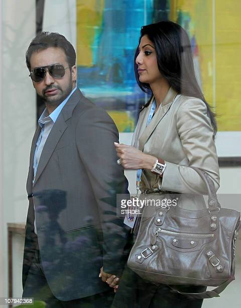 Indian actress and coowner of 'Rajasthan Royals' Indian Premier League cricket team Shilpa Shetty walks with her husband Raj Kundra as they arrive to...