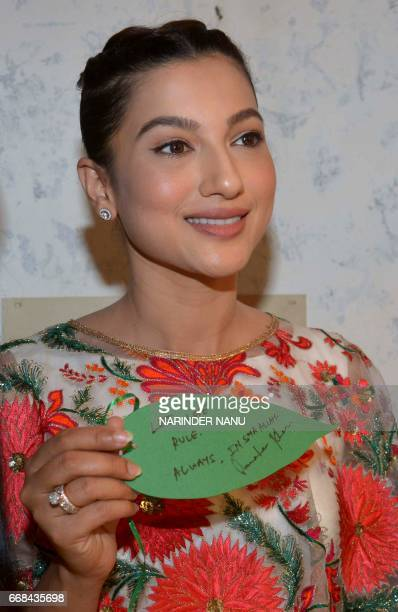 Indian actress Gauhar Khan poses as she takes part in a promotional event for the Bollywood film 'Begum Jaan' at The Partition Museum in Amritsar on...