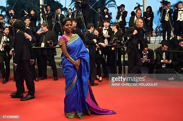 Indian actress Kalieaswari Srinivasan poses before leaving the Festival palace after the screening of the film 'Dheepan' at the 68th Cannes Film...