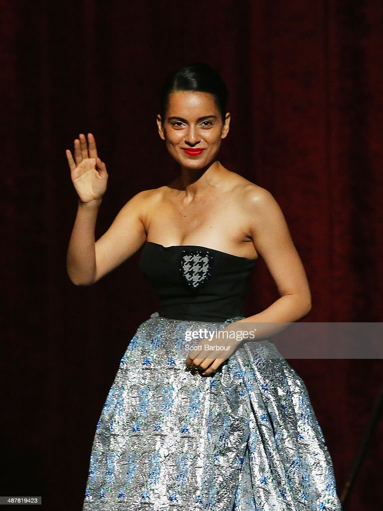 Indian actress, <a gi-track='captionPersonalityLinkClicked' href=/galleries/search?phrase=Kangana+Ranaut&family=editorial&specificpeople=4325041 ng-click='$event.stopPropagation()'>Kangana Ranaut</a> gestures as she walks on stage to accept her award at the Indian Film Festival of Melbourne Awards at Princess Theatre on May 2, 2014 in Melbourne, Australia.