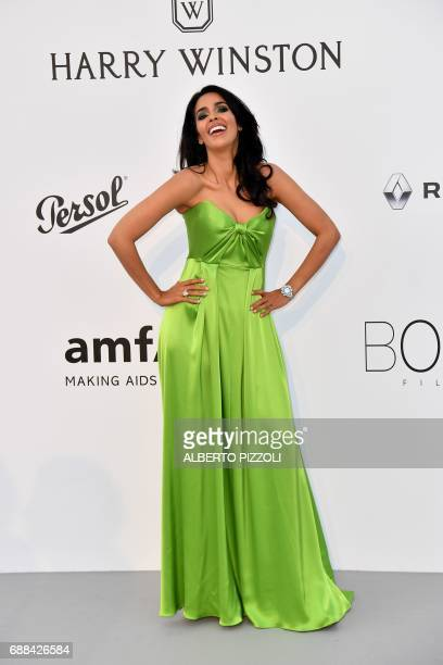 Indian actress Malika Sherawat poses as she arrives for the amfAR's 24th Cinema Against AIDS Gala on May 25 2017 at the Hotel du CapEdenRoc in Cap...