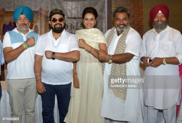 Indian actress Prachi Tehlan poses with actors BN Sharma Hobby Dhaliwal and Shivender Mahal along with director Manduip Singh at a promotional event...