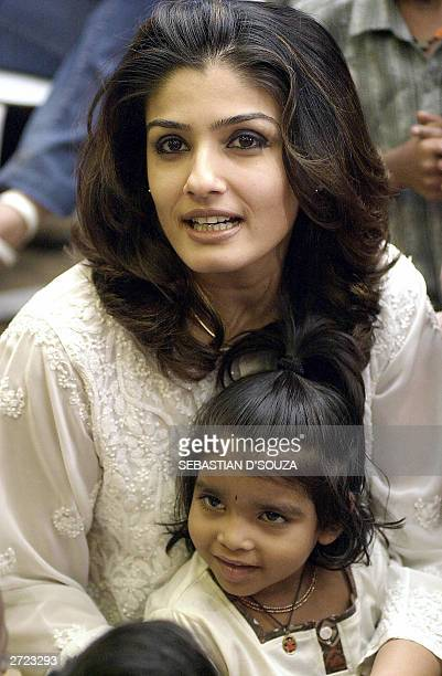 Indian actress Raveena Tandon interacts with underpriviledged children on the eve of Children's Day in Bombay 13 November 2003 Tandon continues her...