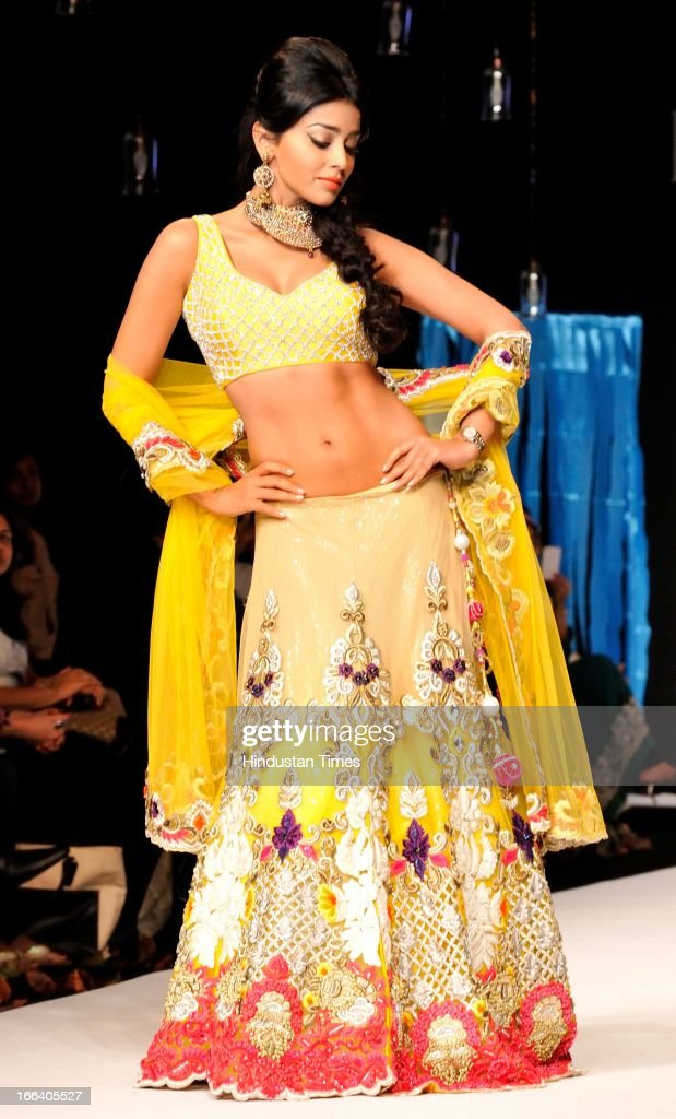 Indian actress Shriya Saran walks the ramp during a fashion show at the Indian Gem and Jewellery Fair on April 12, 2013 in New Delhi, India. Over 100 jewellers and designers are participating in Fair the IGJF is being held from 12th - 15th April, 2013. One of the largest market of gold, India imported $39.5 billion of gold in first nine months of last fiscal and exported gold jewellery to the tune of $12.12 billion in the same period.
