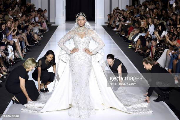 Indian actress Sonam Kapoor presents a creation by Ralph and Russo during the 2017 fall/winter Haute Couture collection in Paris on July 3 2017 / AFP...