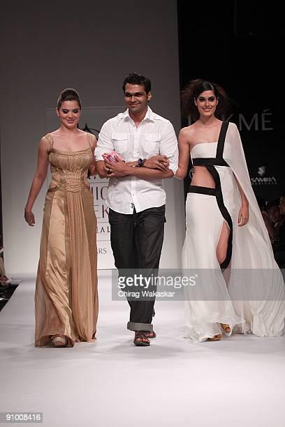 Indian actress Urvashi Sharma walks the runway with fashion designer Swapnil Shinde model Amrit Maghera at the Swapnil Shinde show at Lakme Fashion...