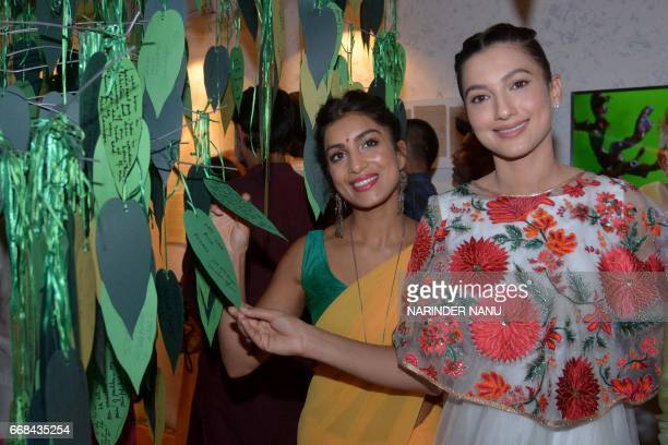 Indian actresses Gauhar Khan and Pallavi Sharda pose during a promotional event for the Bollywood film 'Begum Jaan' at The Partition Museum in...